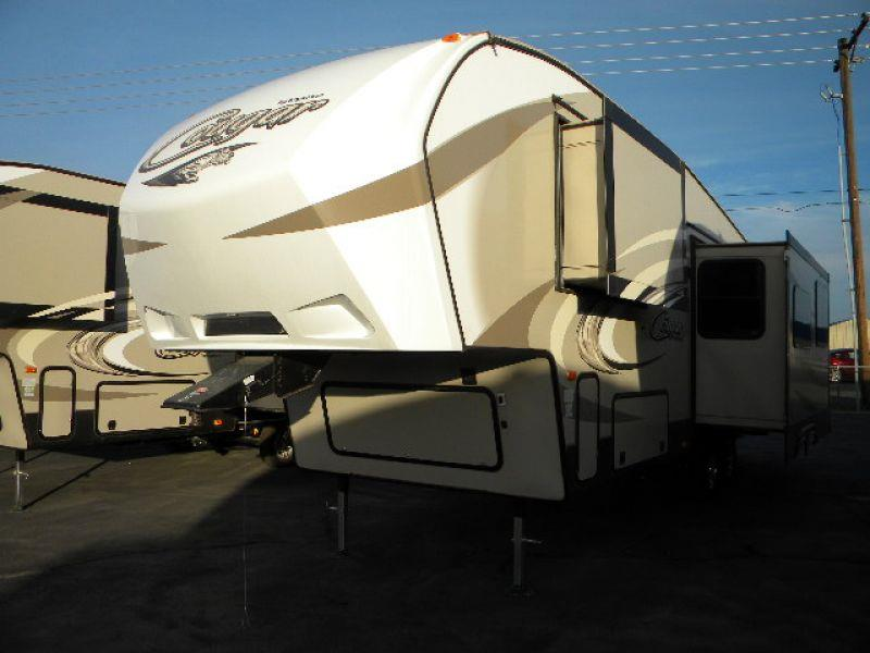 2016 COUGAR 279RKSWE tan this brand new 30g 5th wheel trailer has it all two slides provide a sp