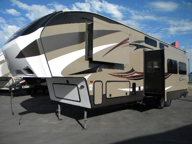 2015 COUGAR 326SRX brown this nearly new 37g cougar 5th wheel trailer has two slides and a ten fo