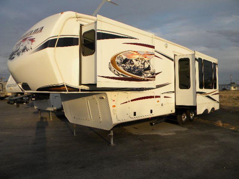 2012 MONTANA 3585SA white this fabulous 38g 5th wheel trailer has it all three slides provide a