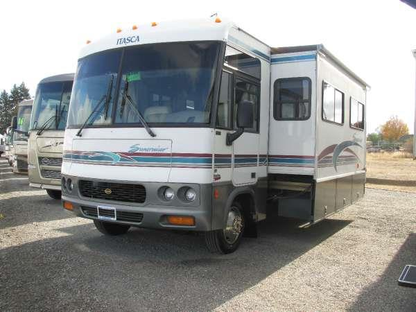 2000 ITASCA SUNCRUISER 35U Lt Blue this 2000 itasca suncruiser has an open and warm feel to it