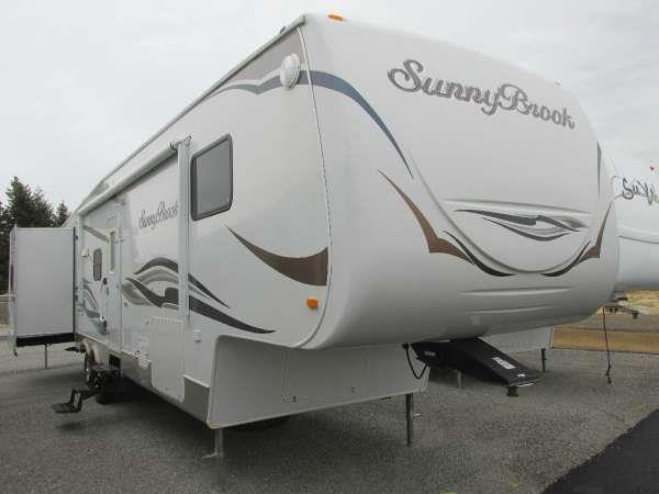 2011 SUNNYBROOK 3425HB neutral this quality 34 ft sunny brook fifth wheel has rear 12 bathroom a