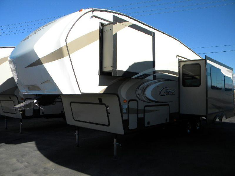 2016 COUGAR 277RLS TAN this brand new 30g 5th wheel trailer has it all two slides provide a spac