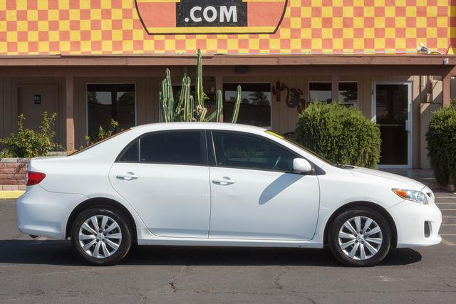 2012 TOYOTA COROLLA 4D SEDAN LE Super White air conditioning power steering amfm stereo power