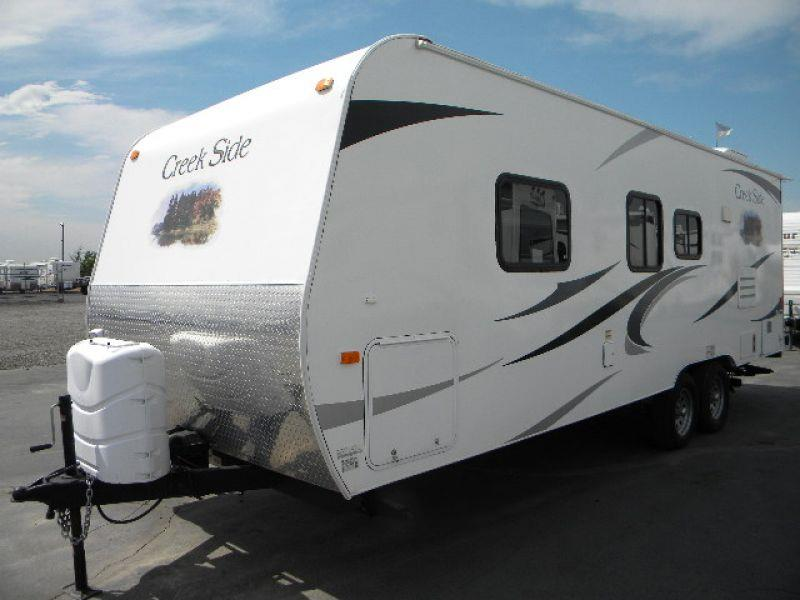 2012 CREEKSIDE 22RB white this very nice little 26g front bed  rear bath model travel trailer ha