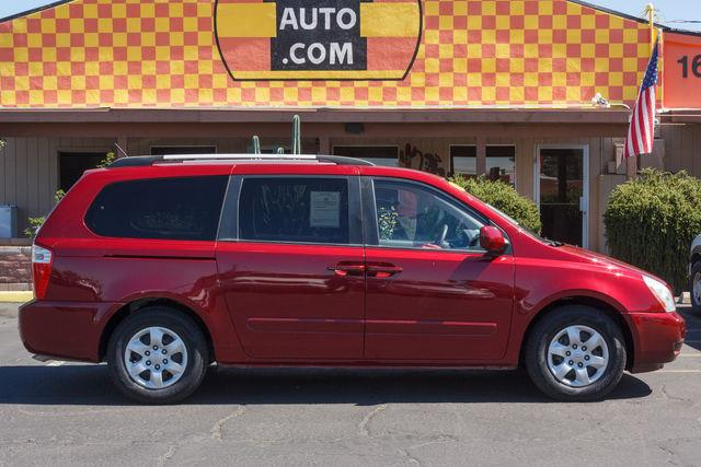 2010 KIA SEDONA 4D WAGON LX Claret Red air conditioning power steering amfm stereo power wind