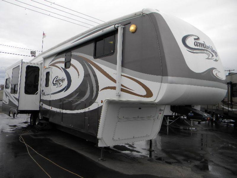 2006 CAMBRIDGE BY KEYSTONE 358RLS WHITE BROWN this gorgeous 39g rear living 5th wheel trailer ha